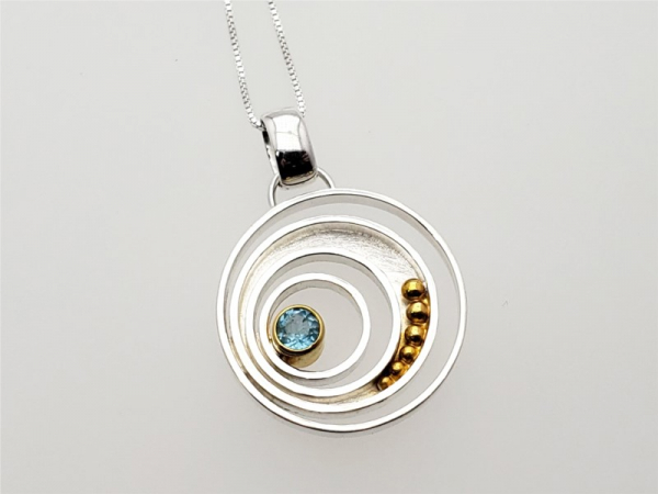 Sterling silver and vermeil pendant and chain with sky blue topaz by Michou