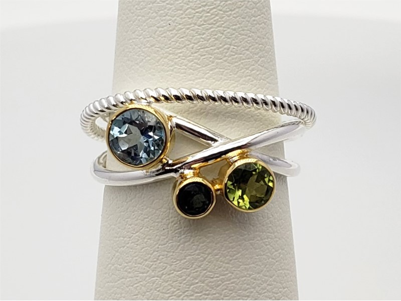 Sterling silver and vermeil with envy topaz, peridot, and sky blue topaz ring by Michou