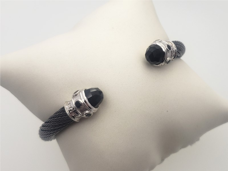 Steel cable with black onyx bangle by Goldman Kolber
