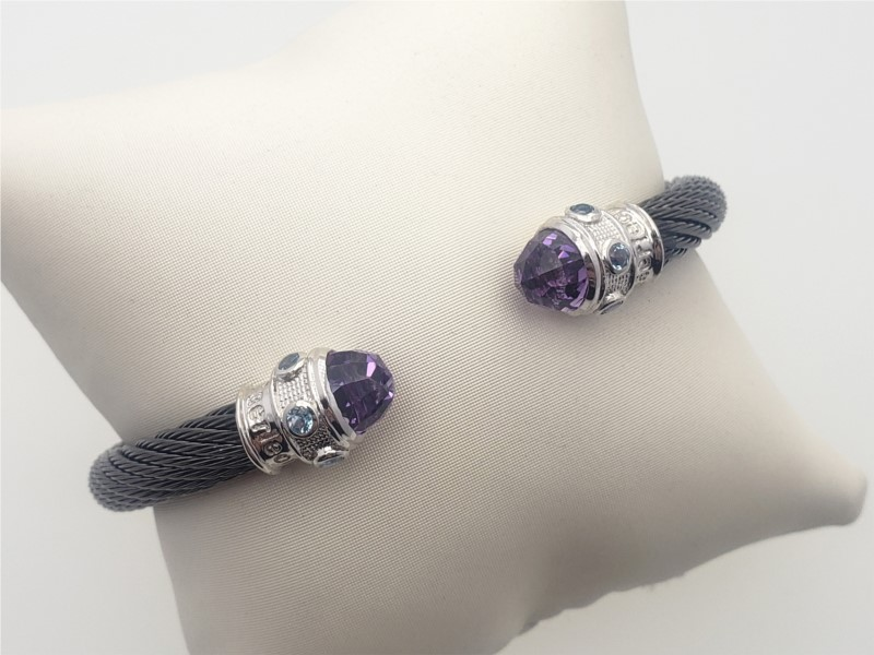 Steel cable with amethyst and blue topaz bangle by Goldman Kolber
