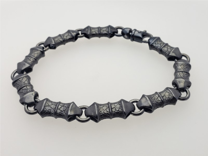 """Genesis"" link bracelet in sating gunmetal sterling silver by William Henry Studio"