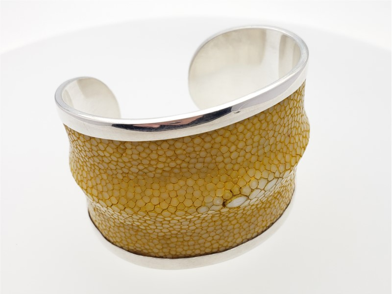 Wilda Gulusha yellow cuff bracelet by Laurent Leger