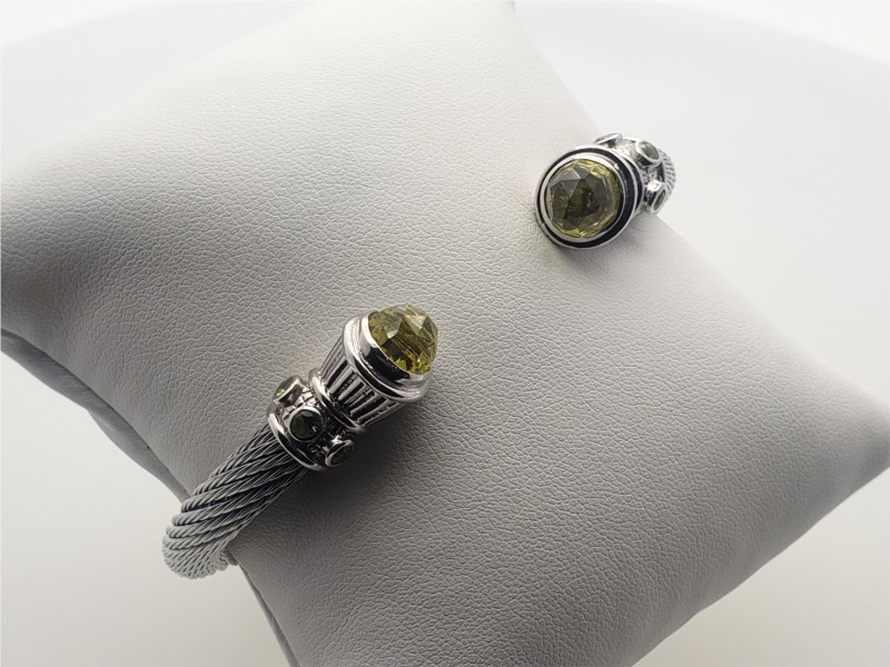 White steel cable open cuff bangle with peridot and lemon quartz by Goldman Kolber